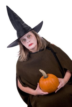 Female witch holding a pumpkin isolated over white Stock Photo - 2110714