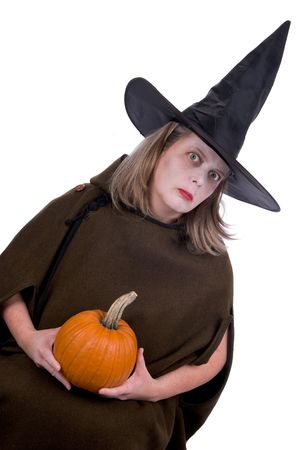 beldam: Female witch holding a pumpkin isolated over white
