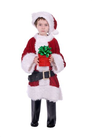 baggy: Boy in baggy Santa Claus suit holding a gift isolated over white