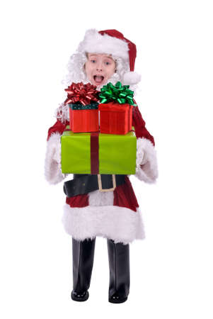 baggy: Boy in baggy Santa Claus suit holding gifts isolated over white Stock Photo