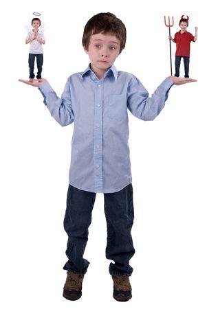 demon: Anioł i diabeł w ręce młodych chłopców izolowanych ponad biały Zdjęcie Seryjne