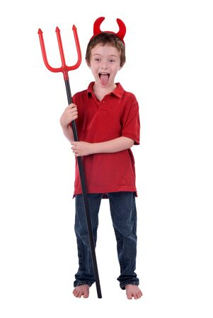 horrify: Young boy in a devil costume with horns and a trident isolated over white