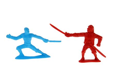 stab: blue and a red plastic toy pirate having a sword fight