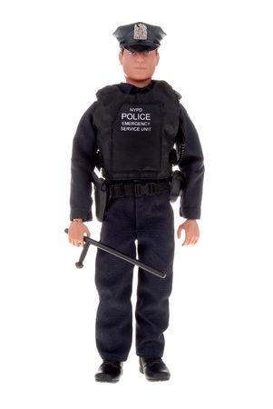 plastic speelgoed politieagent doll met een night stick Stockfoto