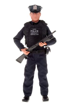 plastic toy police officer doll with a shotgun Banco de Imagens - 2115416