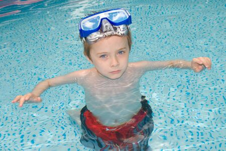 handsome young boy in Swimming Pool with googles Stock Photo - 2115496