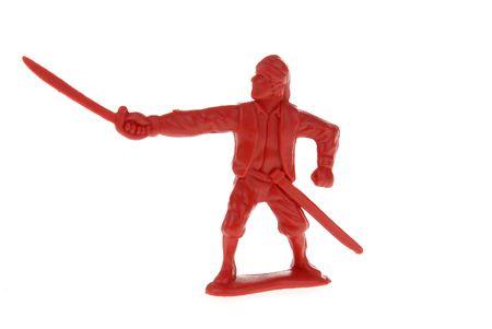 plundering: een rode plastic speel goed piraat met een zwaard Stockfoto