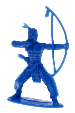 plains indian: blue plastic toy indian shooting an arrow Stock Photo