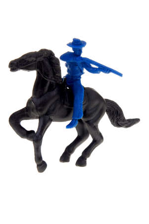 plains indian: plastic toy cowboy on horse