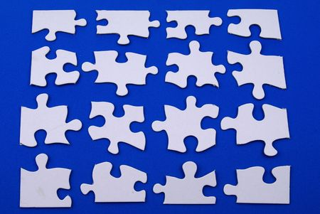 white puzzle pieces over blue 스톡 콘텐츠