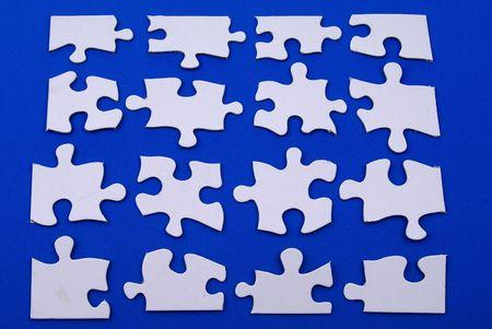 white puzzle pieces over blue Banco de Imagens