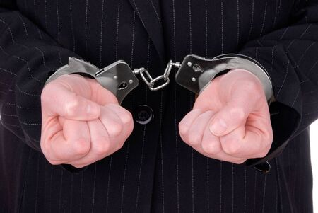 resisting arrest: Business person in suit in handcuffs