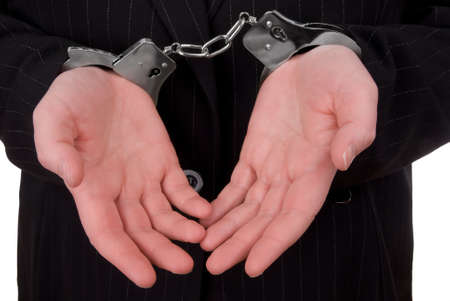 Business person in suit in handcuffs isolated over white Stock Photo - 2115476