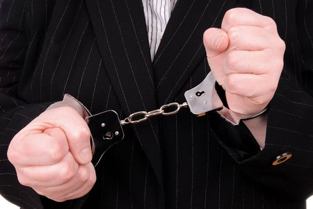 Business person in suit in handcuffs Reklamní fotografie - 2115498