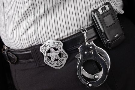 Police detectives belt with badge,cellphone and hadcuffs Reklamní fotografie - 2115592