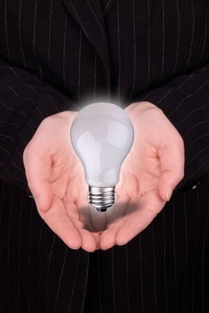 open hands of a business woman with lightbulb