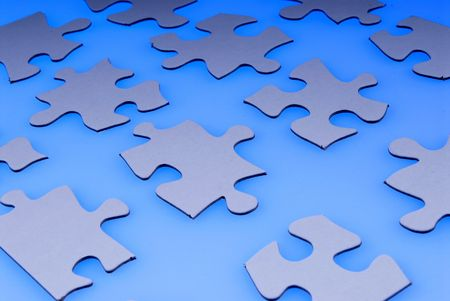 white puzzle pieces over blue Stock Photo - 2115417