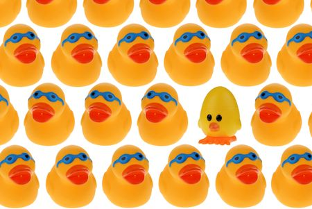 A patterned Group of yellow rubber ducks and a chick wearing blue googles isolated on a white background