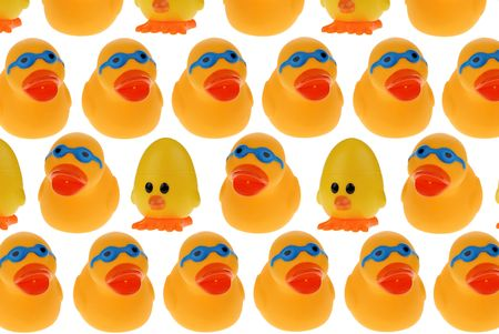 A patterned Group of yellow rubber ducks and chicks wearing blue googles isolated on a white background photo