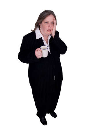 admire: Handsome attractive businesswoman in suit with a cup of coffee in hand with a tired expression on white background  Stock Photo