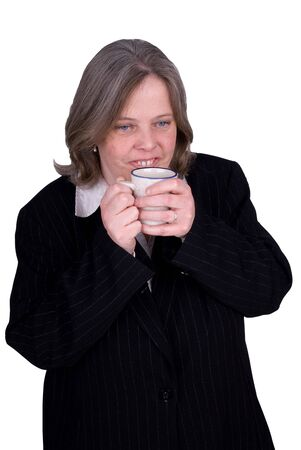 redeye: Handsome attractive businesswoman in suit with a cup of coffee in hand on white background