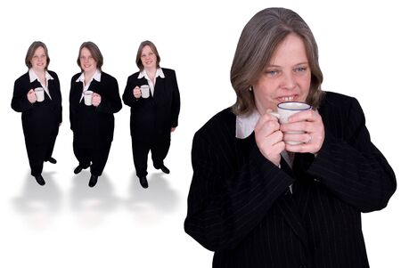 Handsome attractive businesswomen in suits with cups of coffee in hands led by a coffee drinker on white background Stock Photo