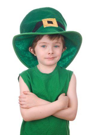 Happy young leprechaun boy wearing a humorous Saint Patricks Day hat. photo