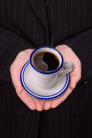 open hands of a business woman with coffee in a gesture of humility Stock Photo
