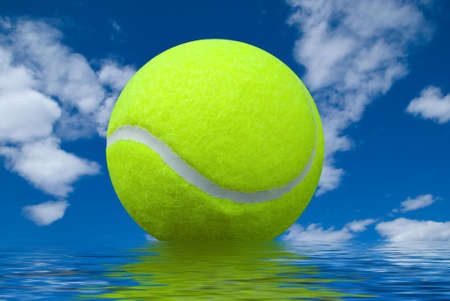 tennis ball isolated over a cloudy sky background with water reflection Stock Photo - 2115454