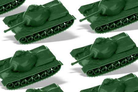 vintage plastic toy tanks with shadows isolated over white photo