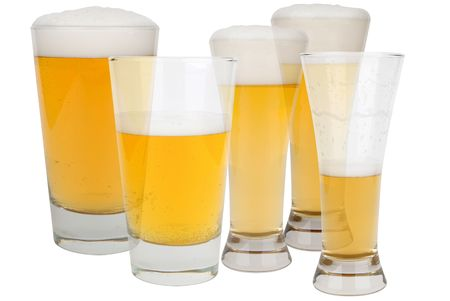 Beer glasses with froth isolated over a white background Stockfoto