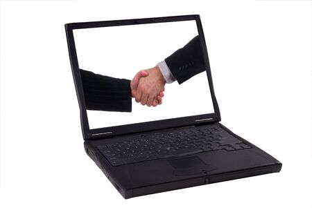 laptop computer with business handshake isolated on a white background  photo