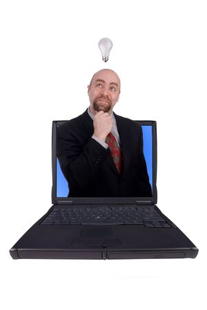 Businessman with idea lightbulb coming out of a laptop isolated over white photo