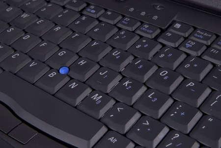 black laptop computer keyboard up close dtail shot photo