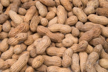 allergic ingredients: large group of peanuts in shells spread out in a pile