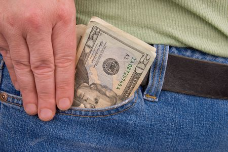 pickpocket: pair of jeans with a womans hand holding a stash of  american paper Money