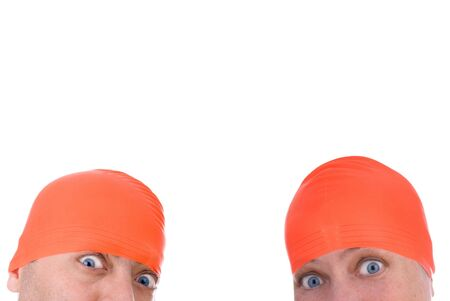Man and woman with an orange swim caps making a funny faces Stock Photo - 2123551