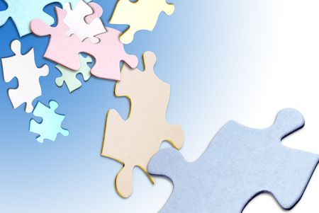Colored puzzle pieces floating over a white background photo