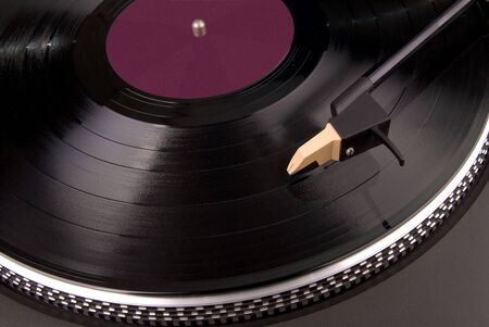 a record playing on a turntable with the needle on the record with the label of the record removed Stock Photo - 2125867