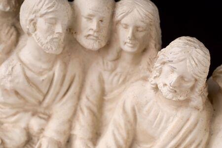 Detail of worn vintage last supper sculpture with focus on Jesus photo