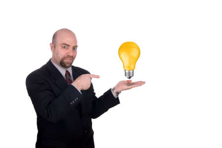 Businessman with a lightbulb in his open hand isolated on white