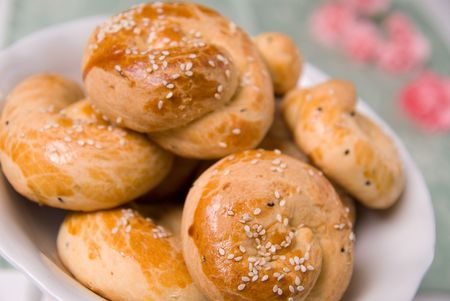 fresh sesame buns on a plate shot in soft focus Stock Photo