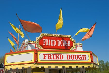 Carnival Fried dough Sign with a blue sky background photo