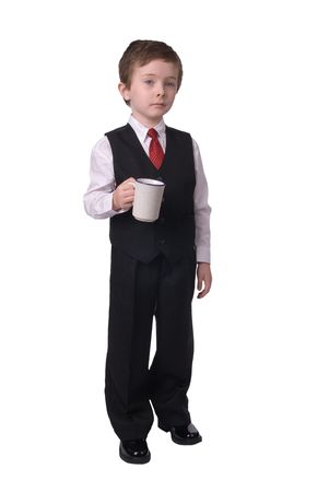 handsome attractive young boy dressed in suit with coffee in hand on white background. Stock Photo - 2120068