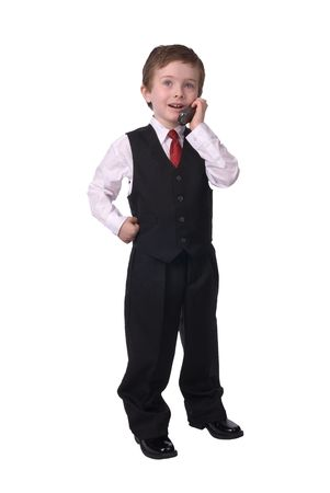 handsome attractive young boy dressed in suit with cell phone in hand on white background.