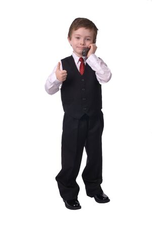 handsome attractive young boy dressed in suit with cell phone in hand on white background. Stock Photo - 2120067