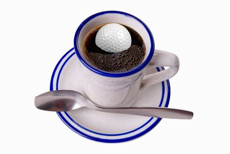 musetti: Cup of coffee with golf ball inside isolated on white background