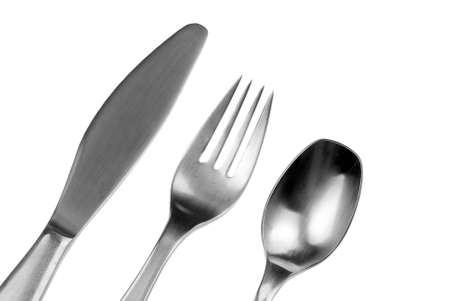 silver metal fork,knife, and spoon isolated over white photo