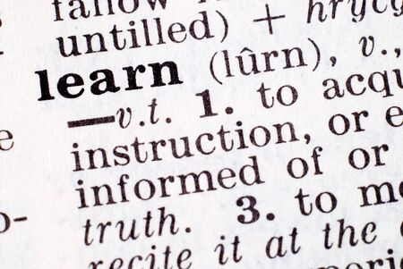 emphasized: Definition of learn emphasized by a macro lens Stock Photo