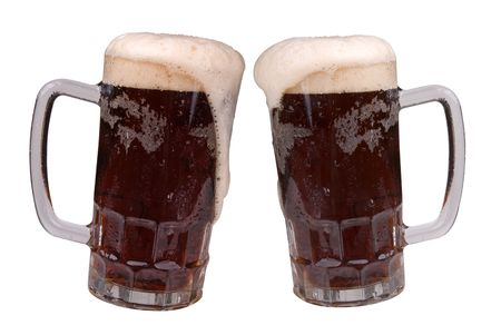 ale: Mugs of Ale with a frothy heads